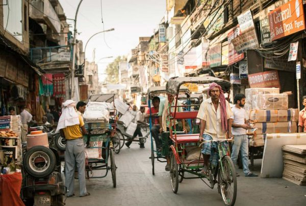 Rickshaw drivers peddling through the streets of Old Delhi. September 18, 2014. iStock.com/Elena Ermakova