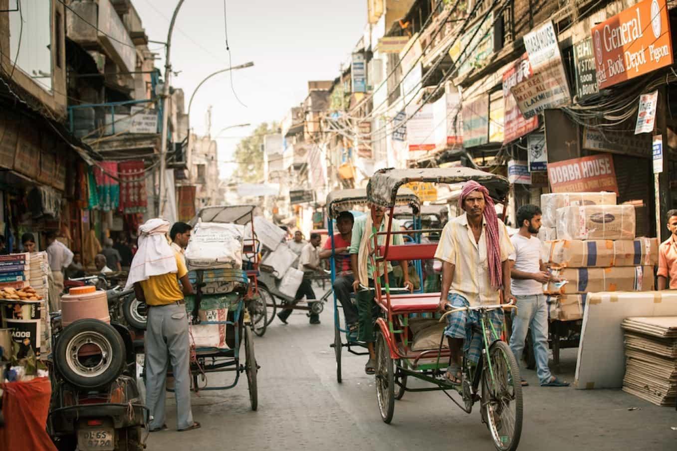Rickshaw drivers peddling through the streets of Old Delhi. September 18, 2014. iStock.com/Elena Ermakova